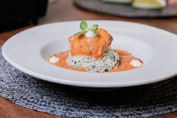 Butter Chicken Served with Spinach Rice